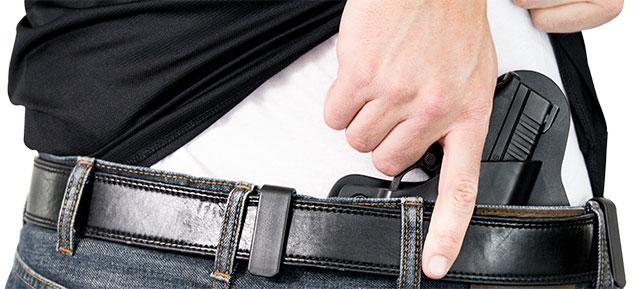 man drawing gun from an iwb holster